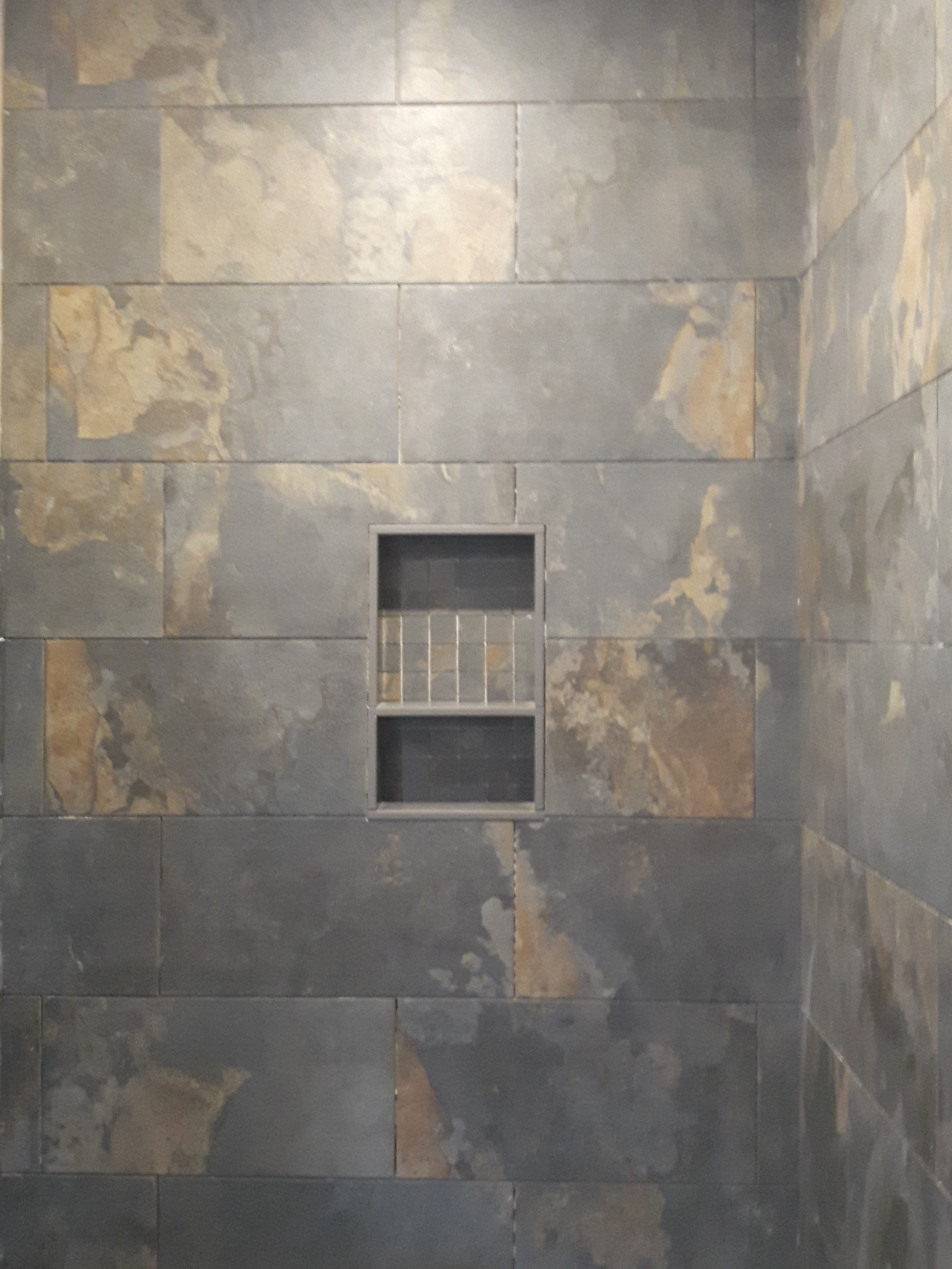 slate tile shower with niche cubby
