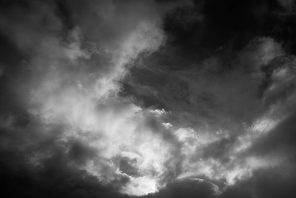 A black and white photograph of dark northern clouds and sky. Photograph by Megan Kennedy