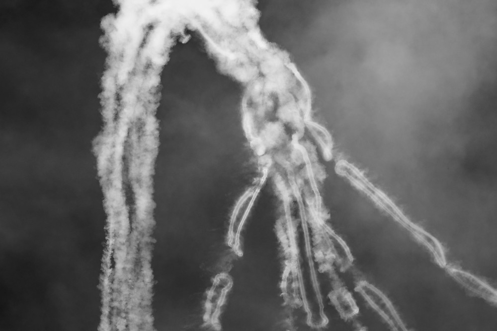 Smoke lingers from the Royal Australian Airforce aerobatics display in PC-21 aircraft in black and white