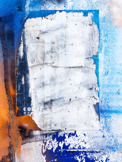 torn white poster on blue background urban abstract photography