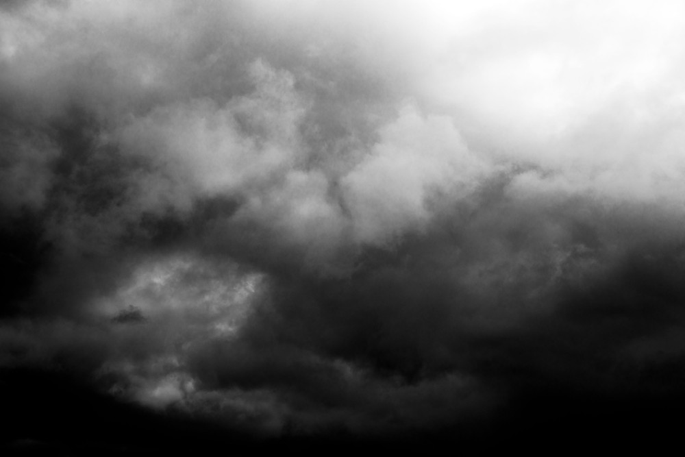 A black and white photograph of dark western clouds. Photograph by Megan Kennedy