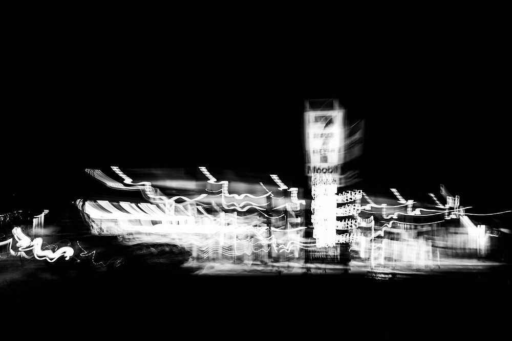 Black and white long exposure icm photograph of a roadside stop by Megan Kennedy