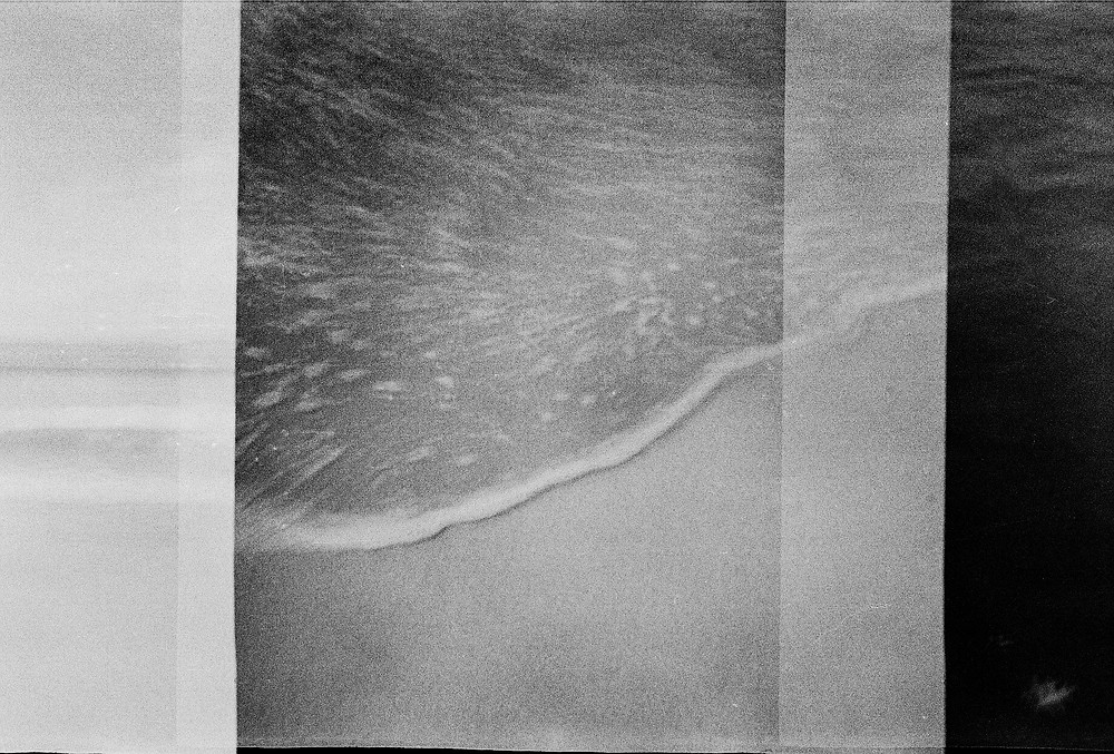 ocean photographed with 35mm film camera square format black and white