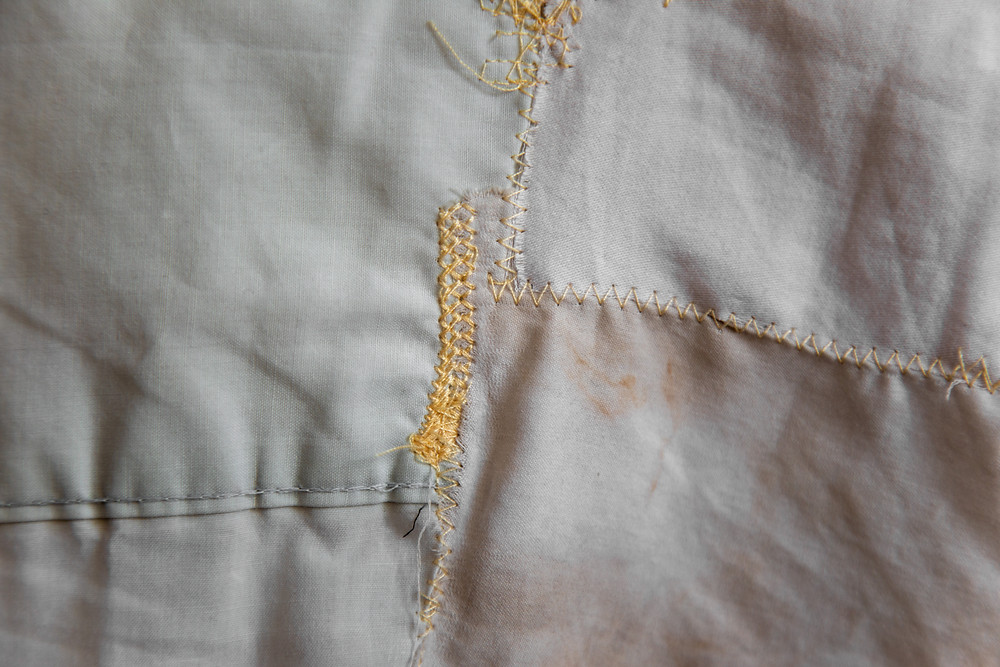 An abstract textile art about chronic illness by Megan Kennedy