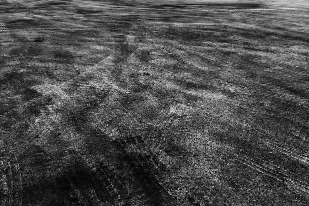 black and white tire tracks marking urban landscape