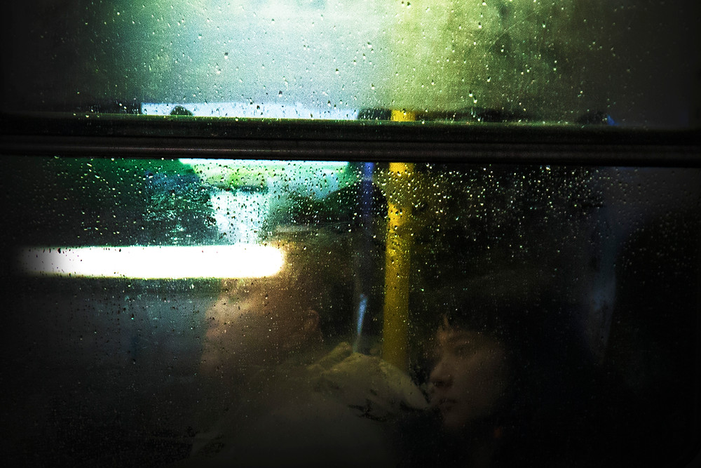 raindrops and fog on window street photography urban