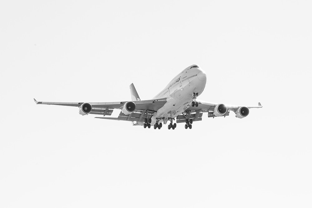 A photograph of VH-OEJ Wunala, the last Qantas 747 jet aircraft arriving at Canberra Airport in black and white photographed by Megan Kennedy