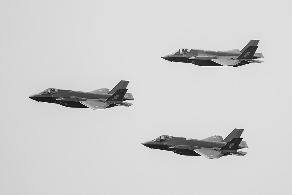 Black and white close up photograph of four F-35 Lightning II's