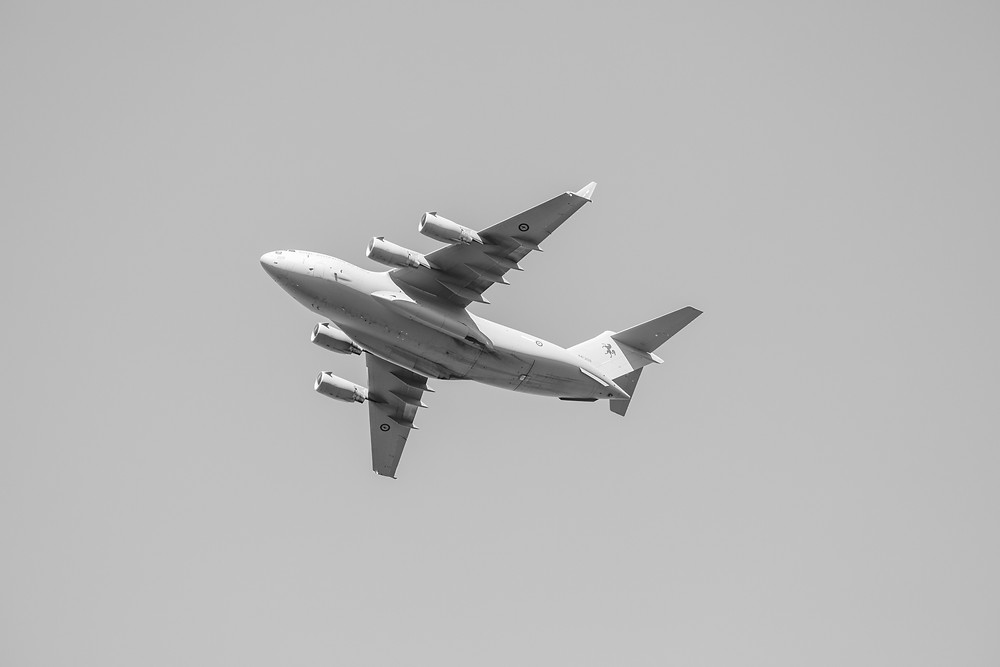 A C-17 aircraft photographed in black and white