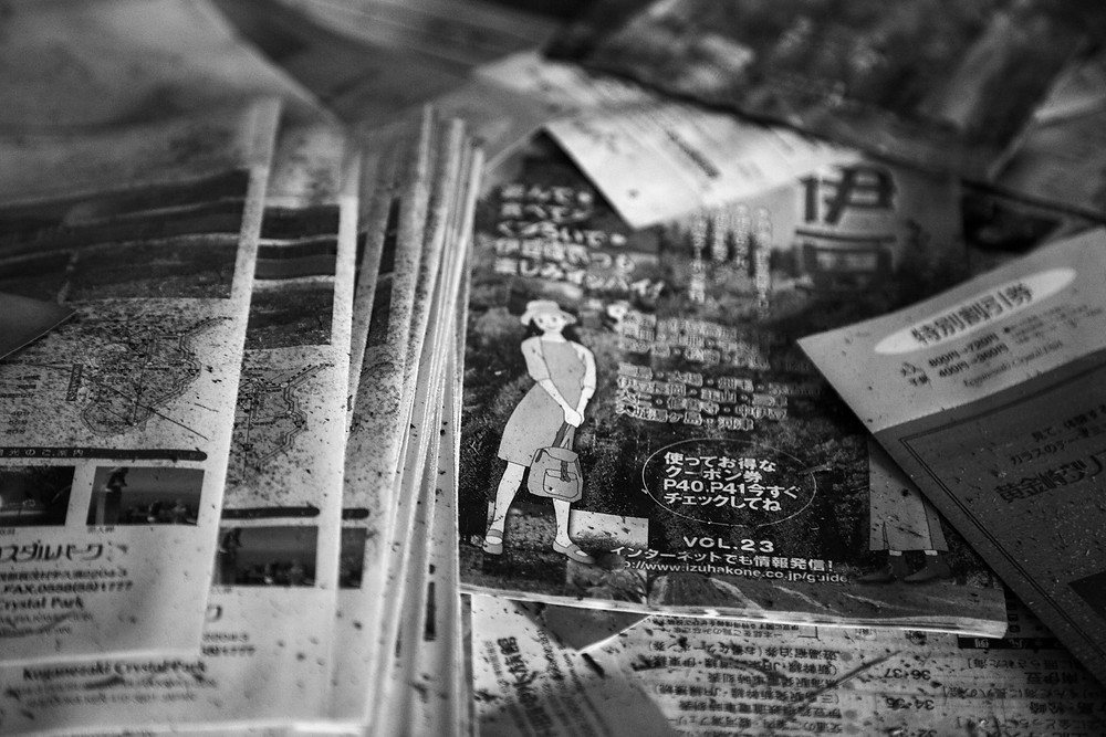 Abandoned and torn brochures from Jungle Park in Japan photographed by Megan Kennedy