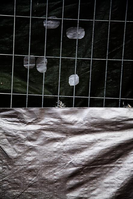 Silver tarpaulin veil urban landscape street photography