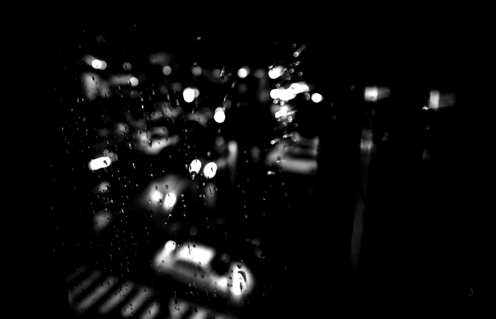 An photograph of a carpark in the rain by Megan Kennedy