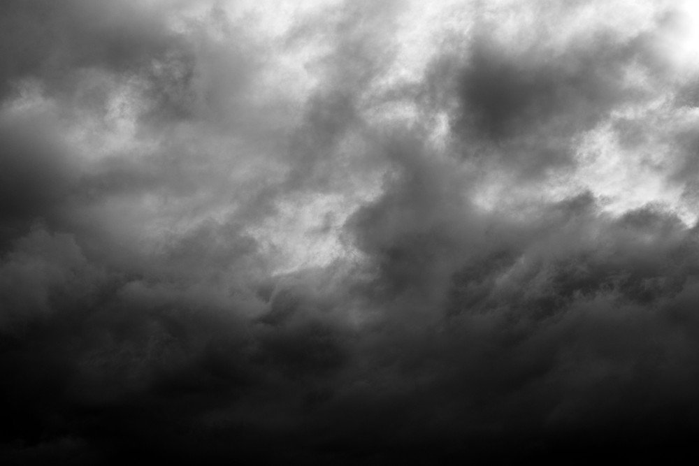 A black and white photograph of dark southern clouds. Photograph by Megan Kennedy