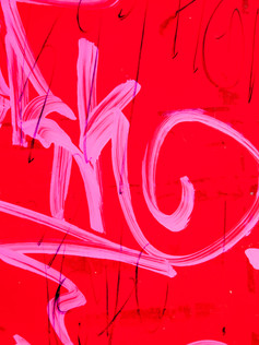 photography of a pink graffiti abstract tag red background