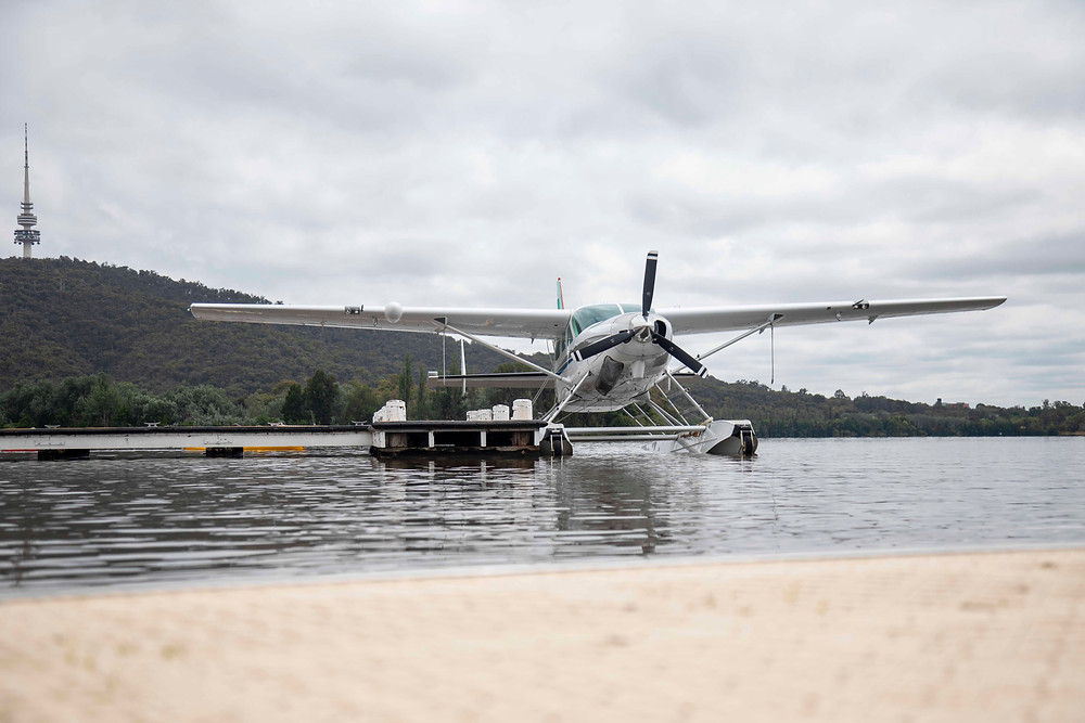 A seaplane moored at Lake Burley Griffin in Canberra, Australia. Black Mountain Tower is in the background.