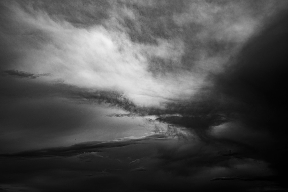 Virga before rainfall and dark clouds in black and white taken by Megan Kennedy