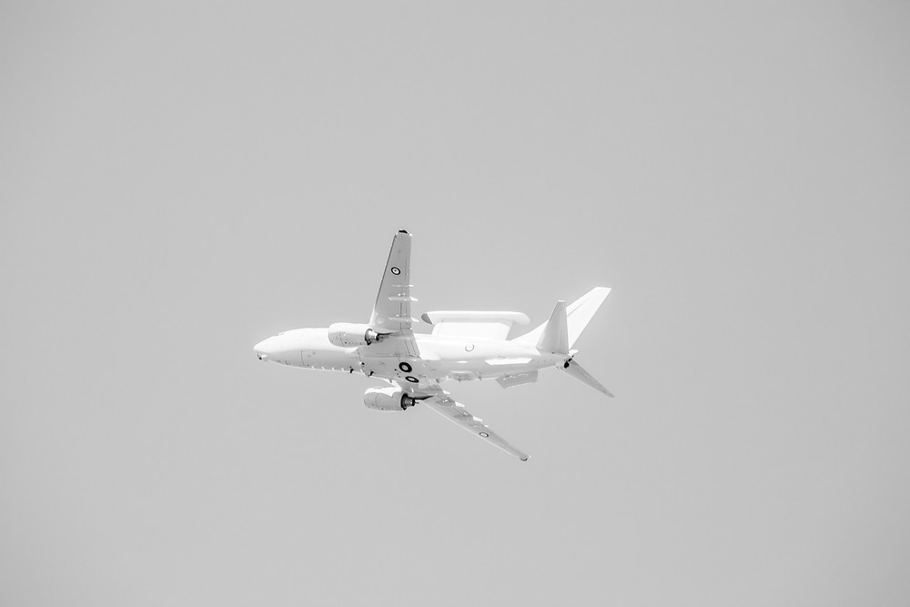 A black and white photograph of a RAAF E-7A Wedgetail illuminated by the sun.