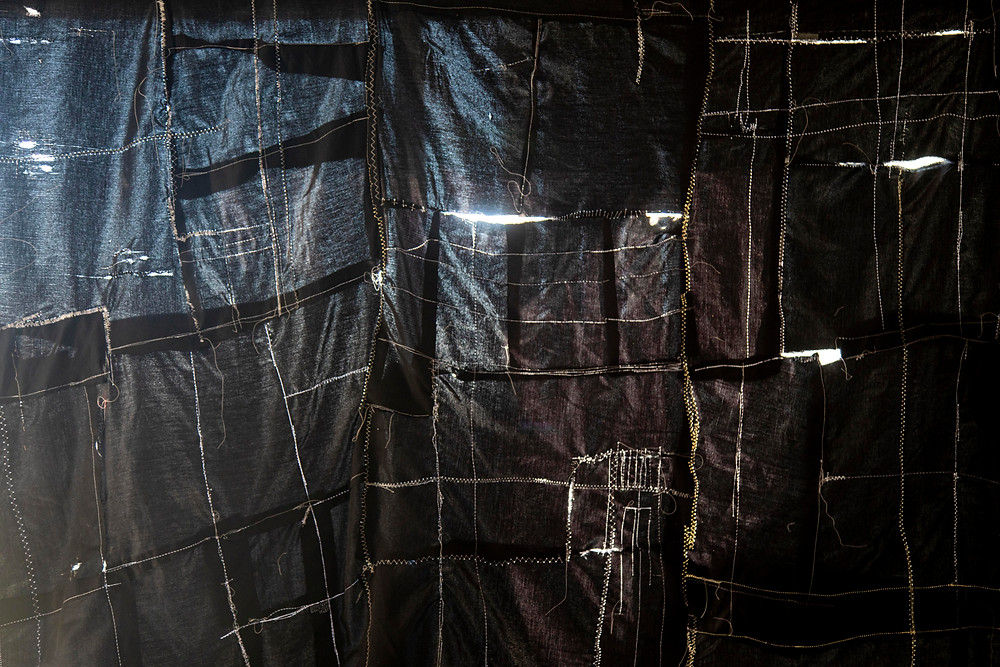 A detail view of Sleep II, an textile response to chronic illness and sleep by Megan Kennedy.