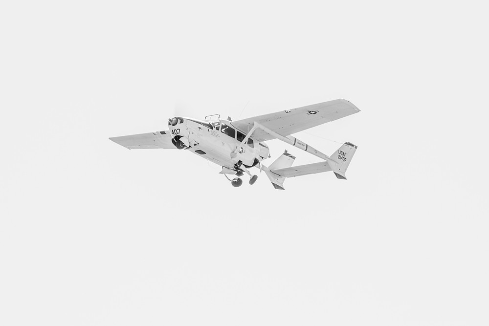 The Cessna O-2A Skymaster in black and white photographed by Megan Kennedy
