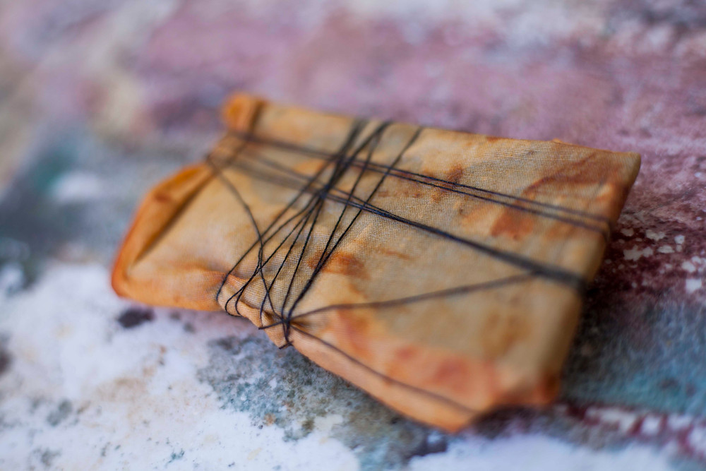 rust dyeing fabric wrapped in string