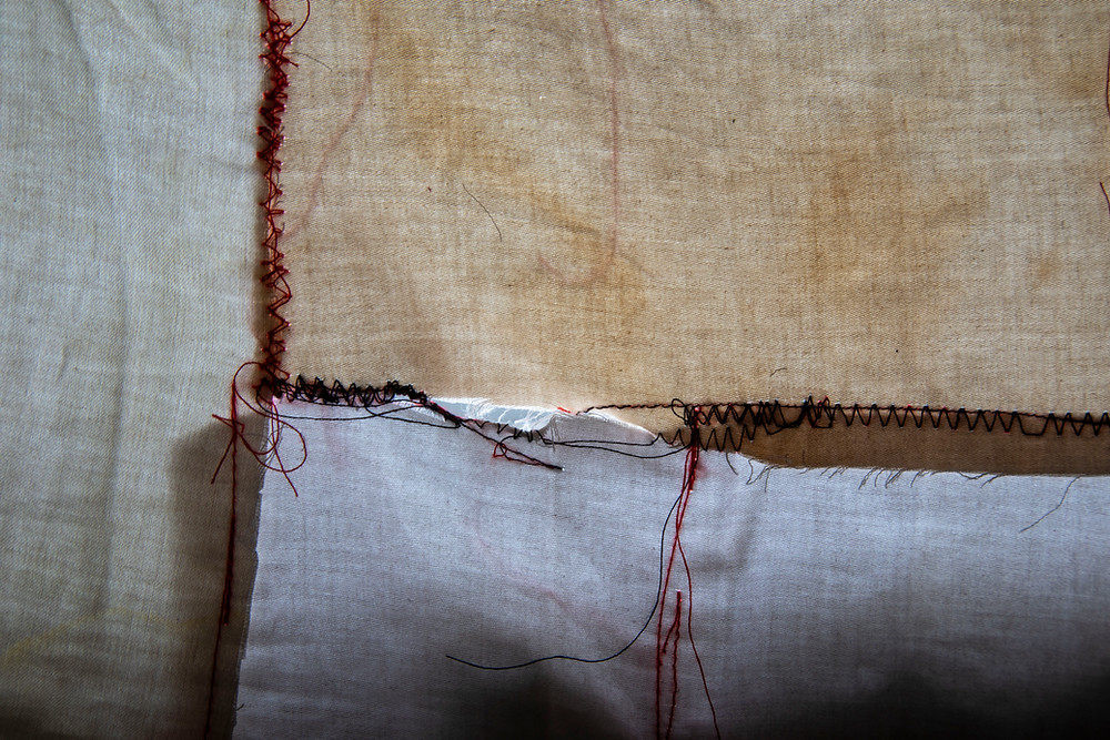 Details of a textile artwork representing the materiality of sleep and chronic illness by Megan Kennedy