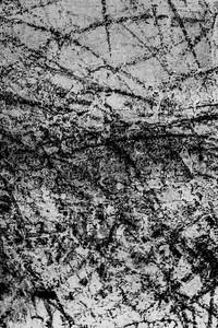 Dark black markings made on an urban landscape