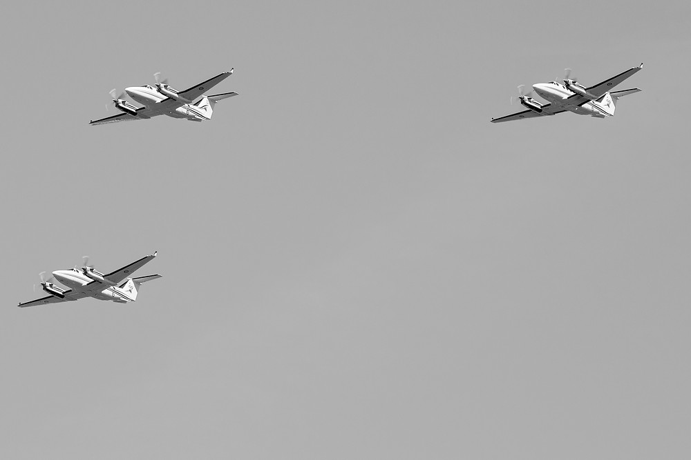 Three B300 King Air 350 aircraft flying in formation at Lake Burley Griffin in Canberra