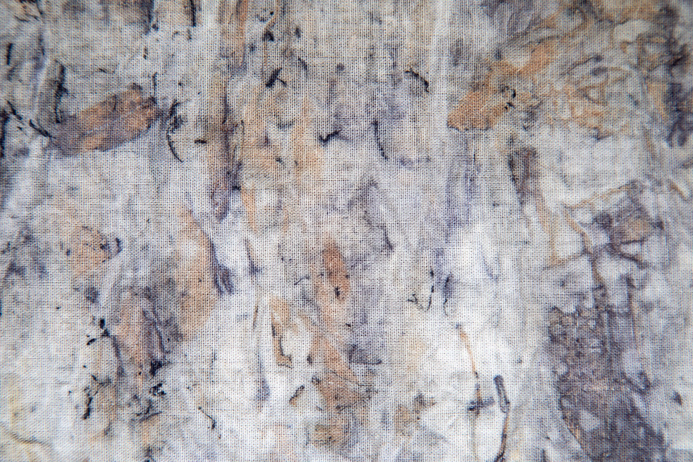abstract eco printing fabric results with brown and blue markings