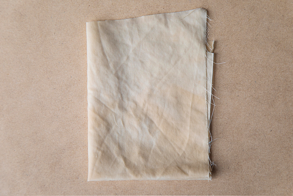 A piece of fabric naturally dyed with coffee by Megan Kennedy