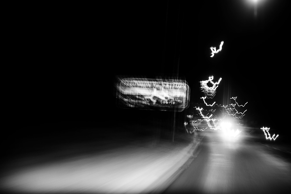 Black and white long exposure icm photograph of a traffic sign by Megan Kennedy