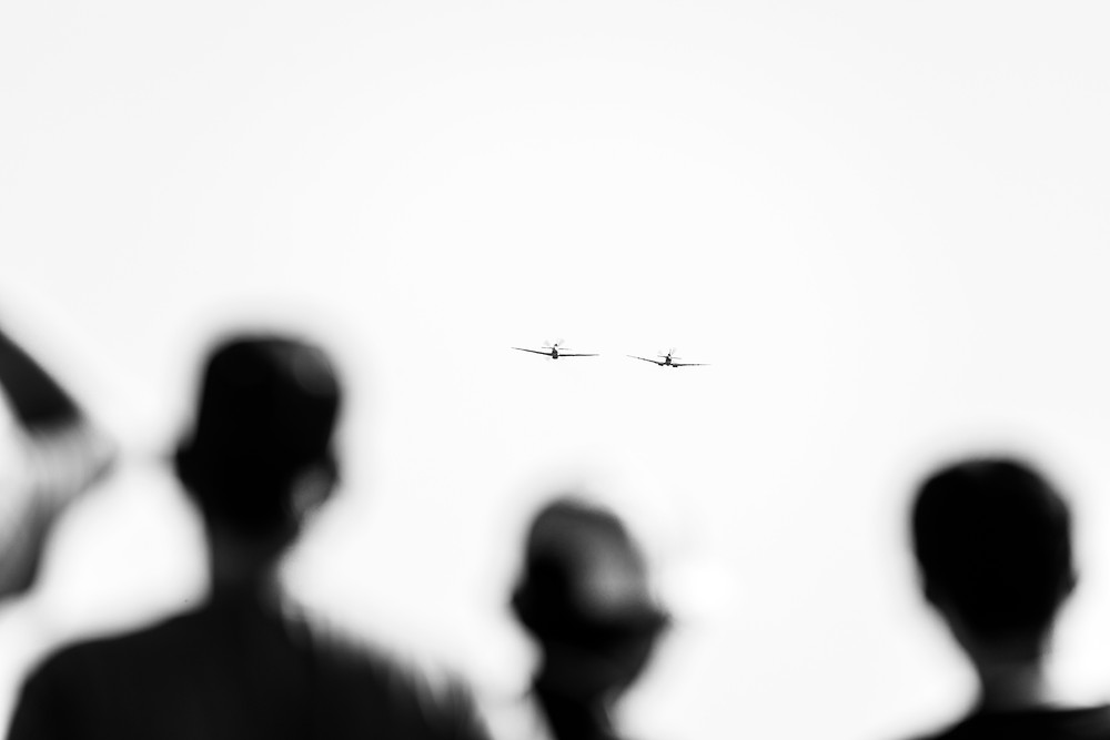 The silhouettes of the crowd watching a display at Temora Aviation Museum. Photographed by Megan Kennedy