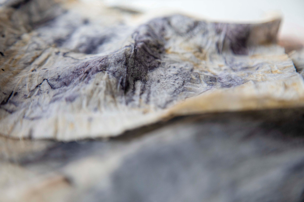 layers of eco printed fabric dyed with eucalyptus leaves