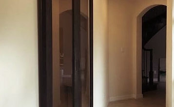 Any Hallway Can Be Sexy With A Mirror Door