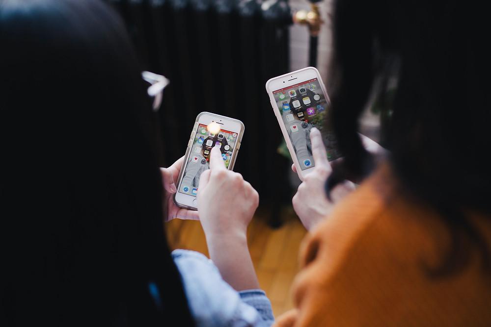 Women using iphones