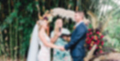 Fun, experienced Brisbane and Gold Coast marriage celebrant conducting a wedding with a stunning wedding arbour.
