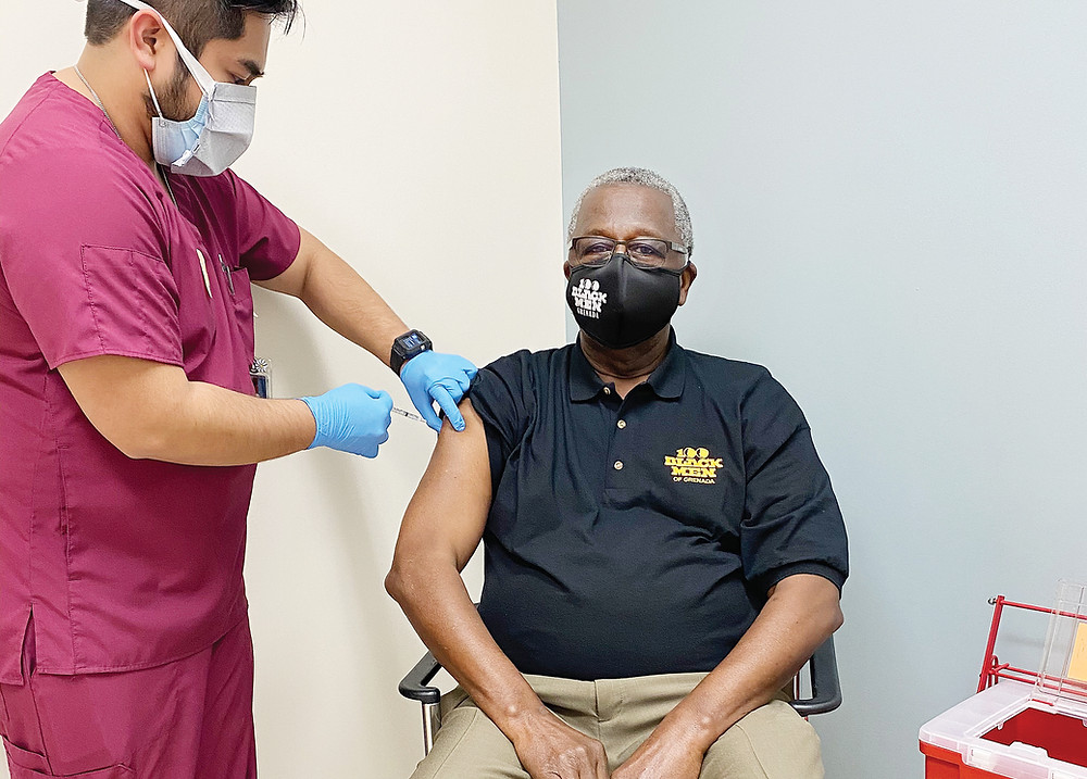 More African-Americans are getting vaccinated. 100 Black Men member gets Covid-19 vaccination.