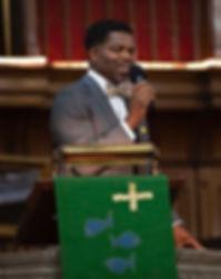 Pastor Brennan speaking crop.jpg