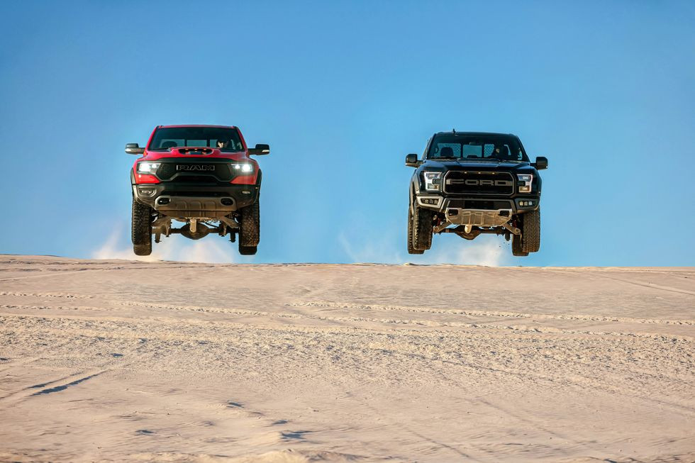 Ford F-150 Raptor and RAM 1500 TRX airborne.