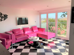 Pink sofas with beautiful views