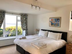 Downstairs twin or zip together bedroom with en suite