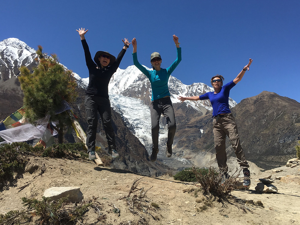 Dr. Ng with veterinary volunteers Zhiyu Chua and Dr. Tharm with Gangapurna Glacier in Manang.