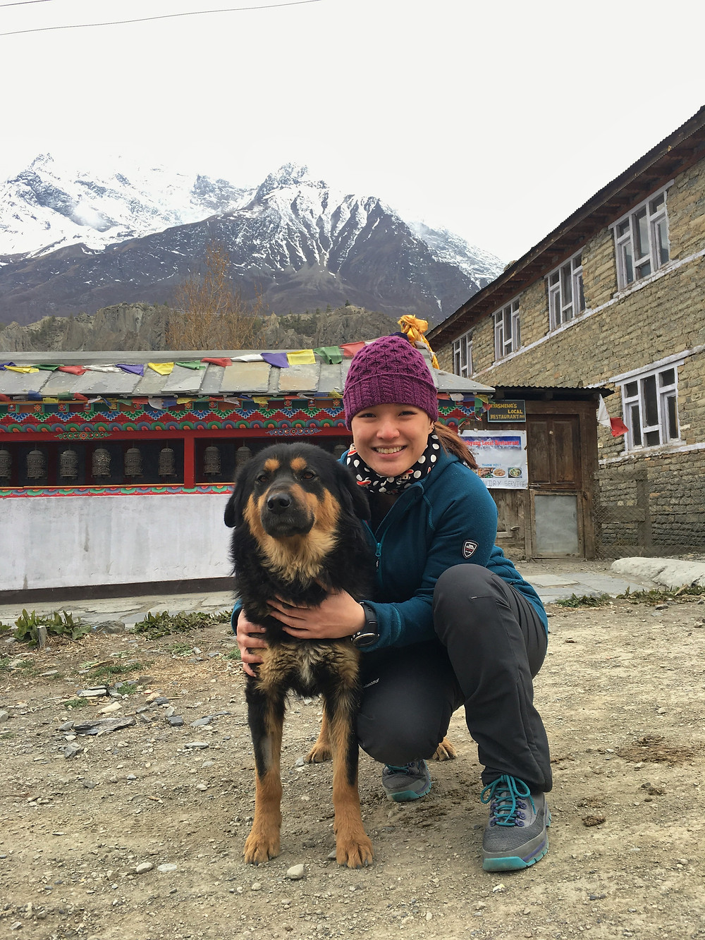 Dr. Ng with a Himalayan mutt in Manang