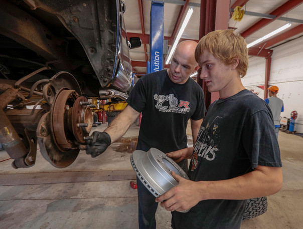 youth working on car.jpg