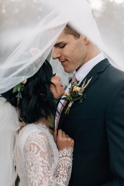 Bride and groom cuddled together during their Arizona wedding. captured by Christina J Photography.