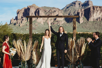 Arizona wedding photographer. Bride and groom at desert wedding in Arizona with view of the superstition mountains. Christina J Photography.
