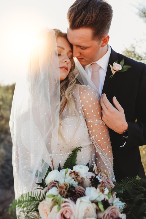 Christina J Photography captures beautiful couple in Scottsdale Arizona desert with dreamy golden light. Bride and Groom portrait.