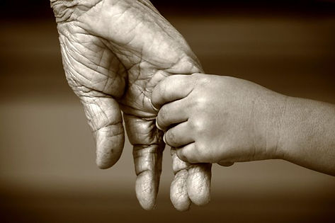 elderly-woman-and-child-holding-hands-75