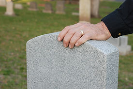 old-Man-s-Hand-Resting-On-Headstone.jpg