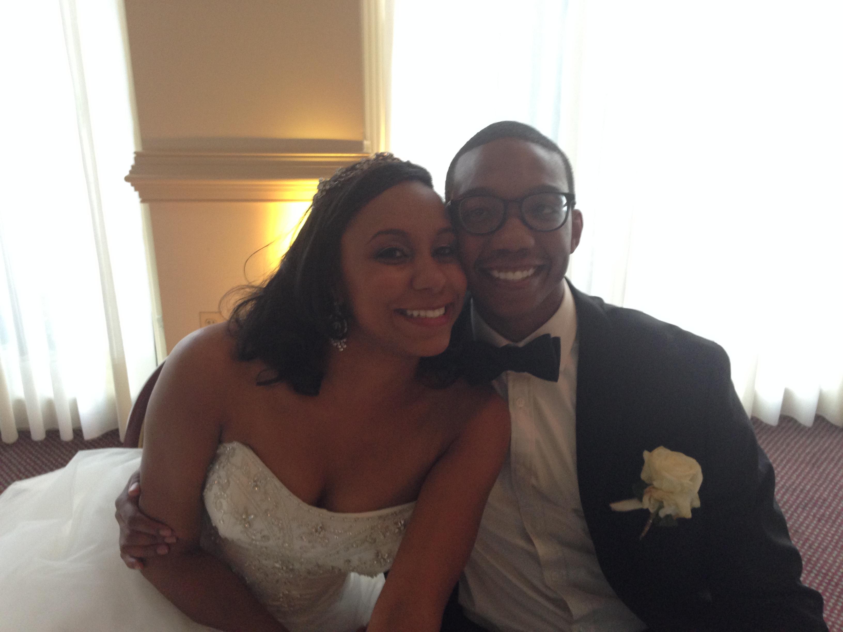 Blushing bride, happy groom