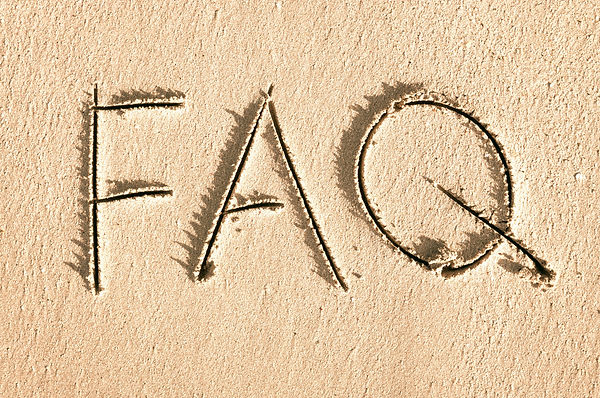 Simple FAQ message, the abbreviation for Frequently Asked Questions, handwritten outdoors